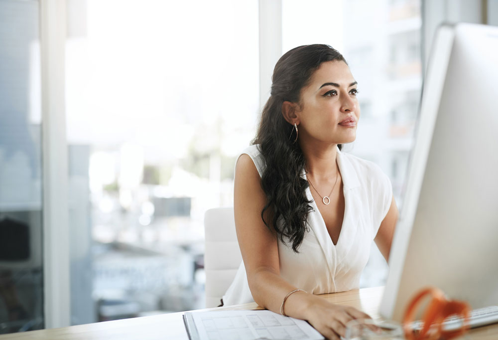 Business woman reviewing her computer