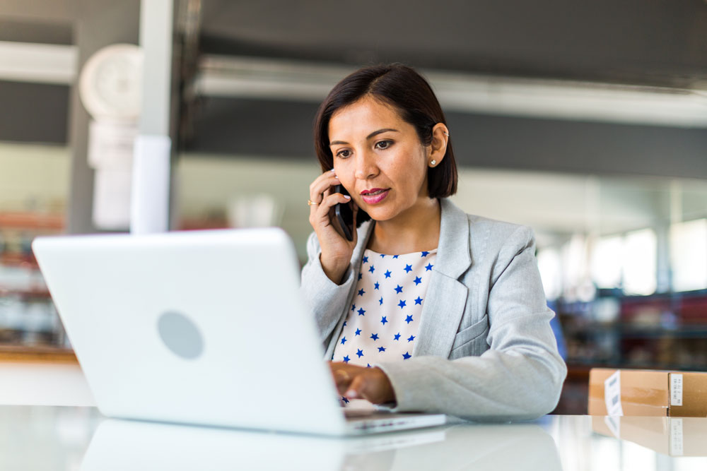 Female business owner reviewing her broadway bank online banking