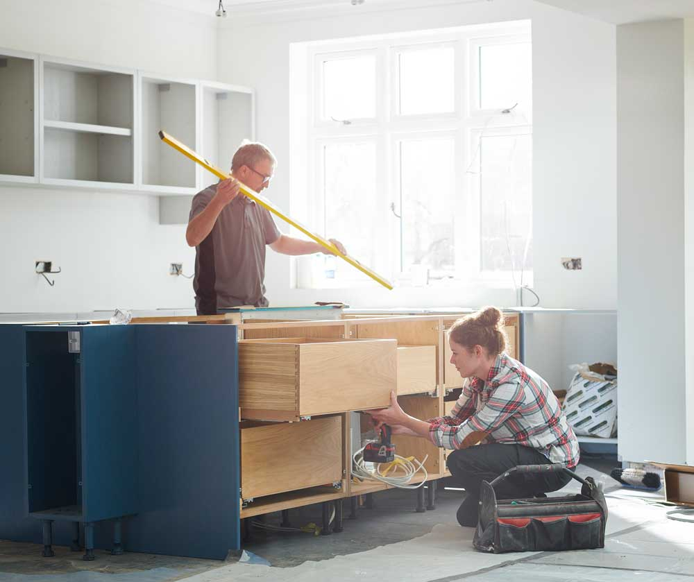 Couple working on remodel of their kitchen