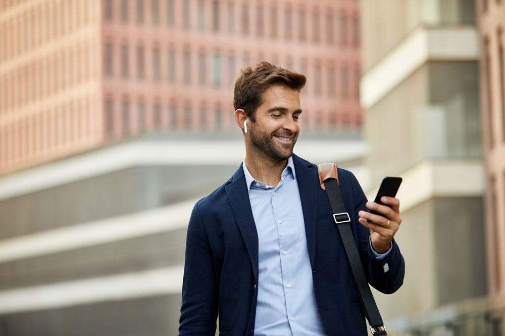 Man looking at his Broadway Bank direct deposit on his phone