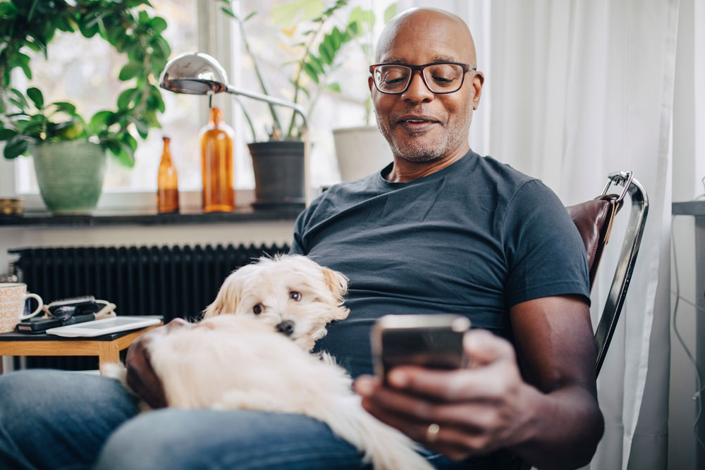 Man reviewing home equity calculator with his dog