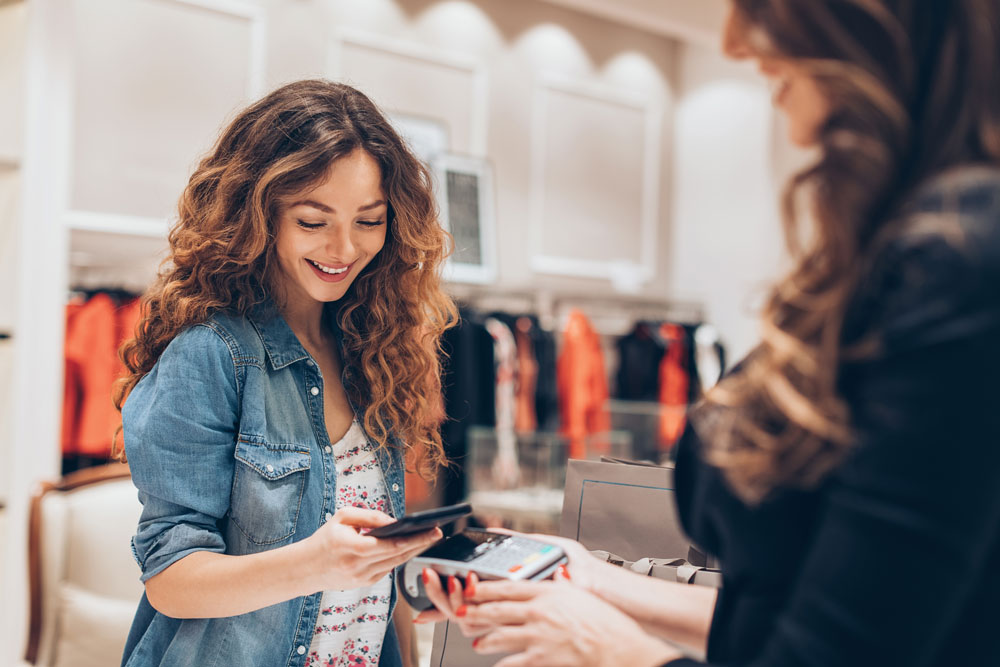 Customer using mobile processing payment in a fashion retail