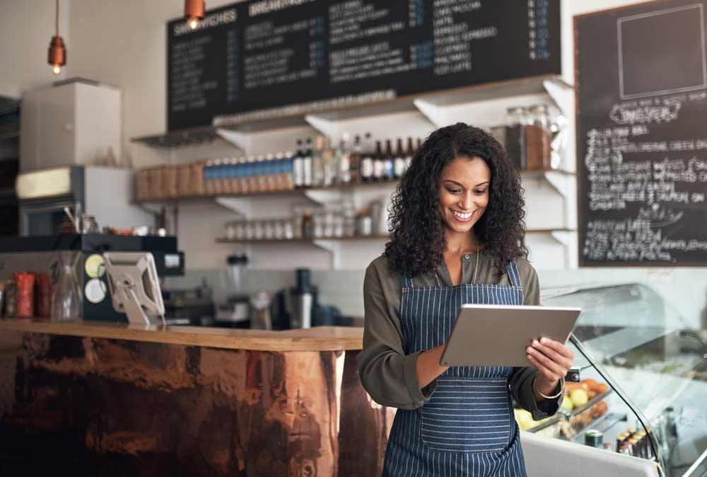 Woman Café owner on tablet