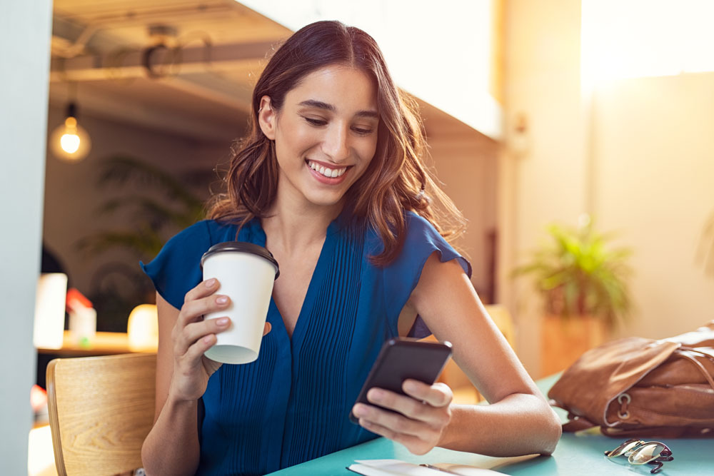 Woman using smartphone to review ibiz app