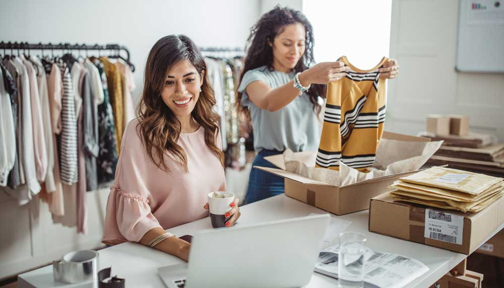 Two business women working to fulfill customer orders