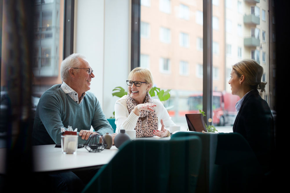 a couple meets with their advisor to talk through their investment strategy