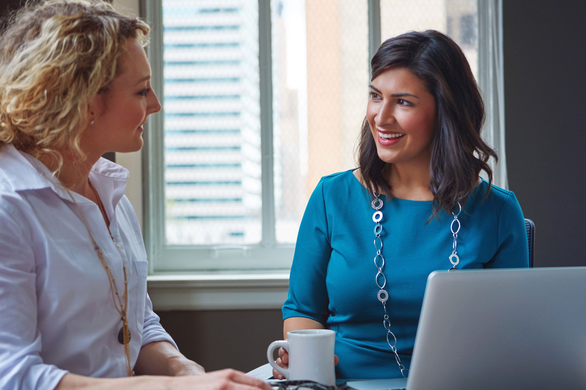 a Broadway Bank Private Banker meets with her client