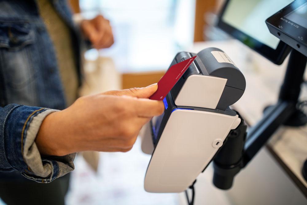 a Broadway Bank Visa® Platinum Credit Card making a contactless payment