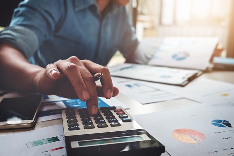 A Business Money Market Account manager using a calculator
