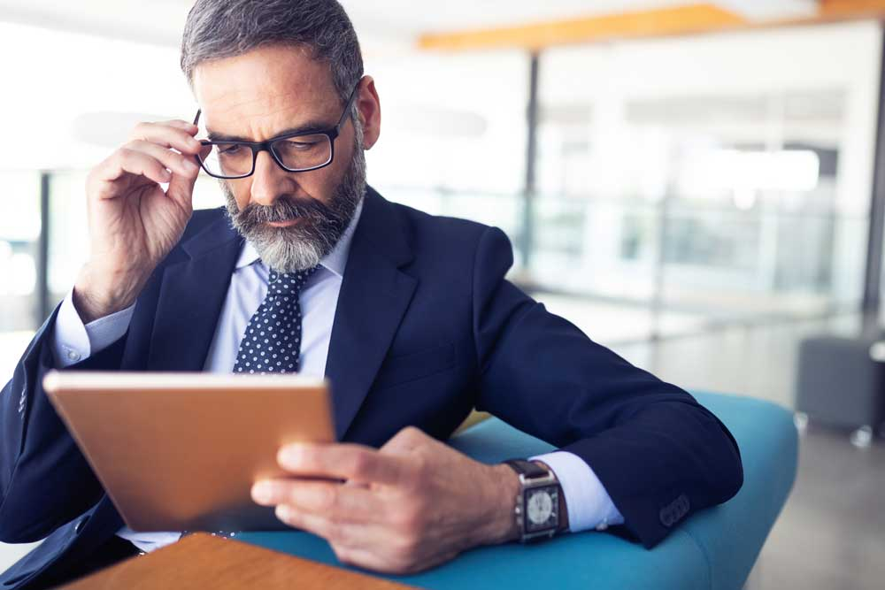 a business professional reviews his investment loan options