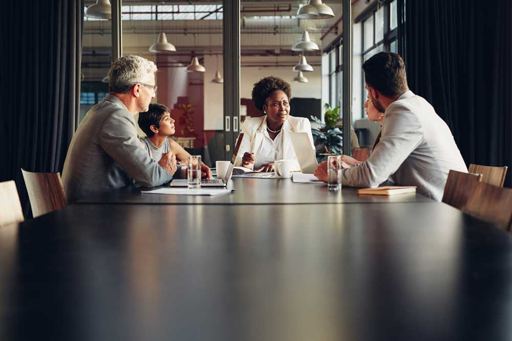 a business team meets in a conference room