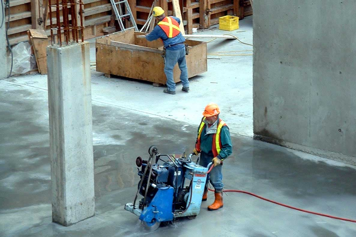 a construction worker works on a commercial building project