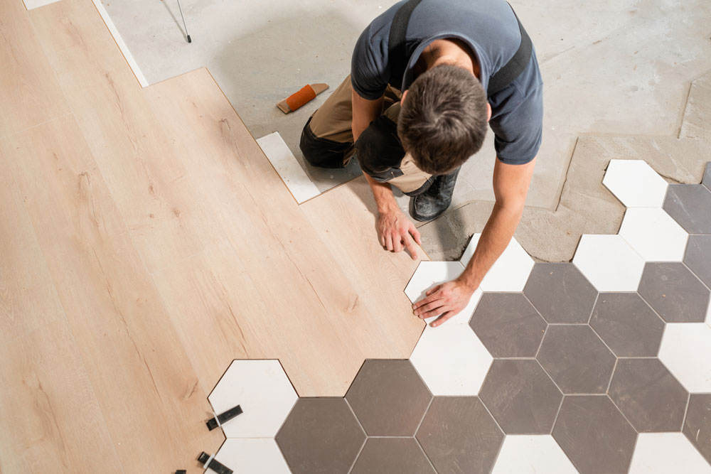 a general contractor lays a new floor