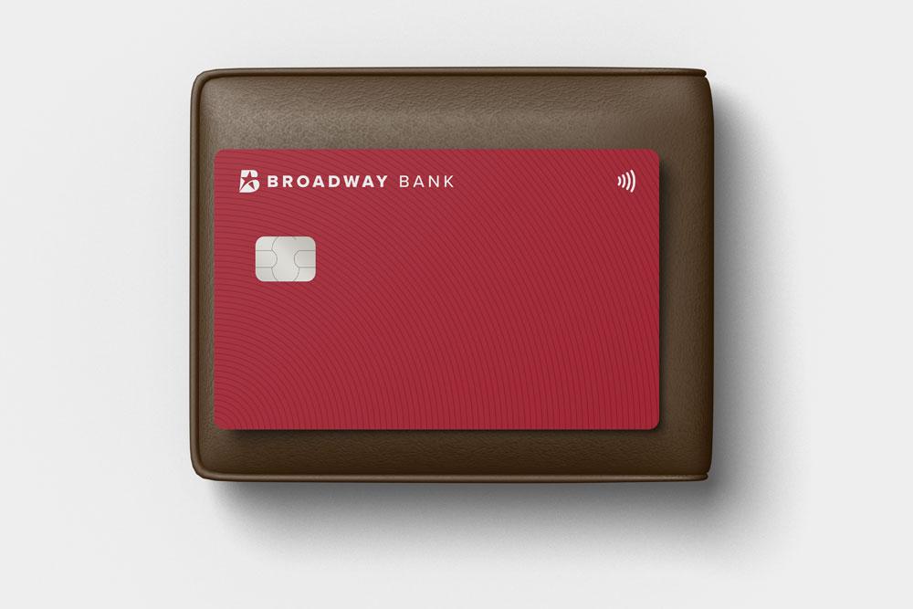 A Broadway Bank Visa® Real Rewards Credit Card sitting on top of a wallet