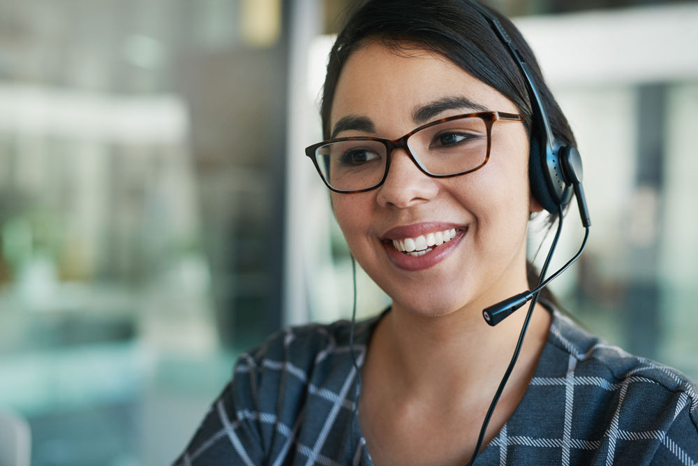 A Broadway Bank Customer Service representative speaks with a cusotmer