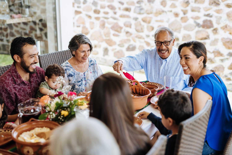 a family enjoys dinner together