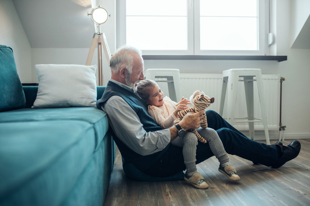 a grandfather plays with his granddaughter