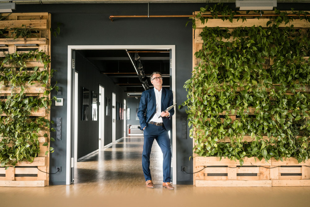 A business man looks at new office space for business use
