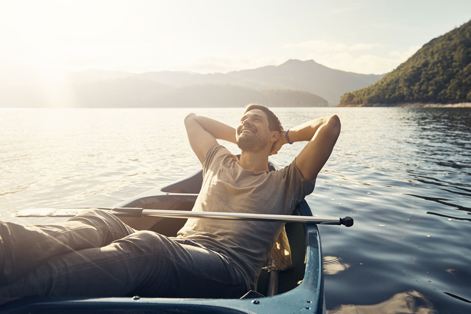 a man relaxes in his boat on a lake