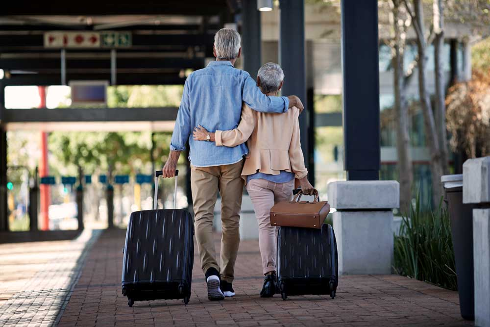 an older couple travels the world together