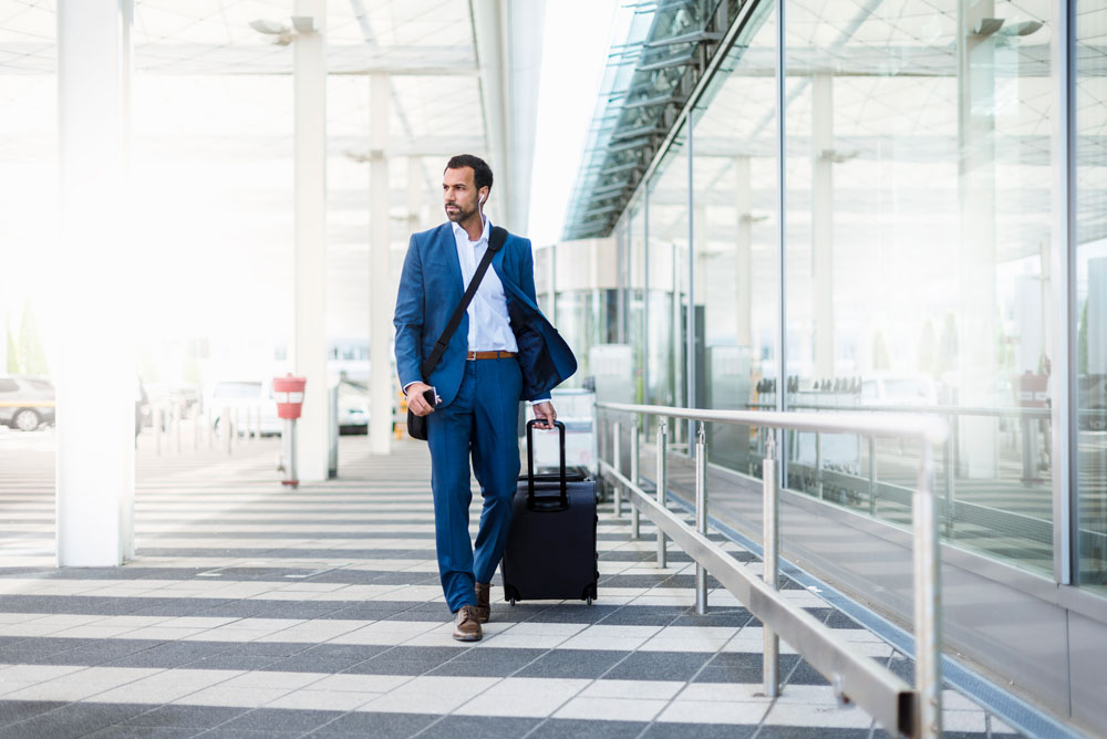 a professional man walking through an airport