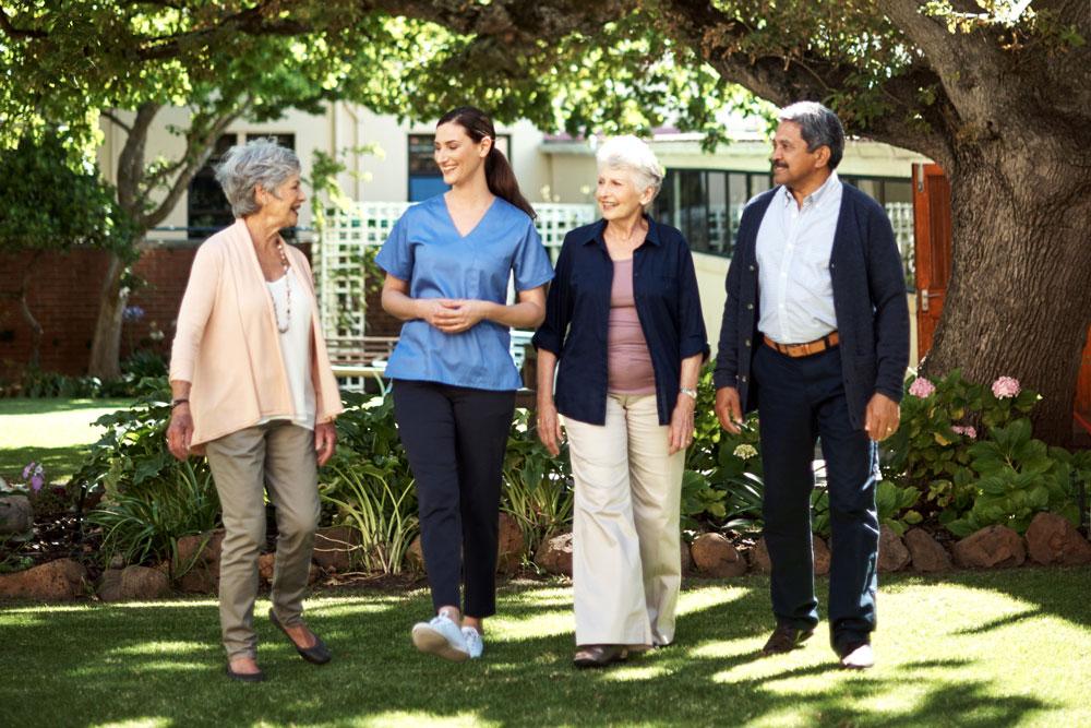 residents walk through their senior care facility