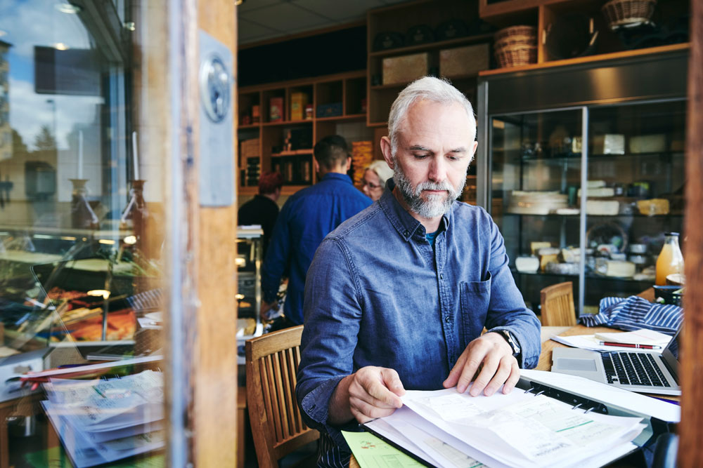 a small business owner manages finances with iBIZ Small Business solution