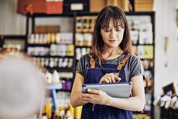 Female business owner holding a tablet while conducting business inventory