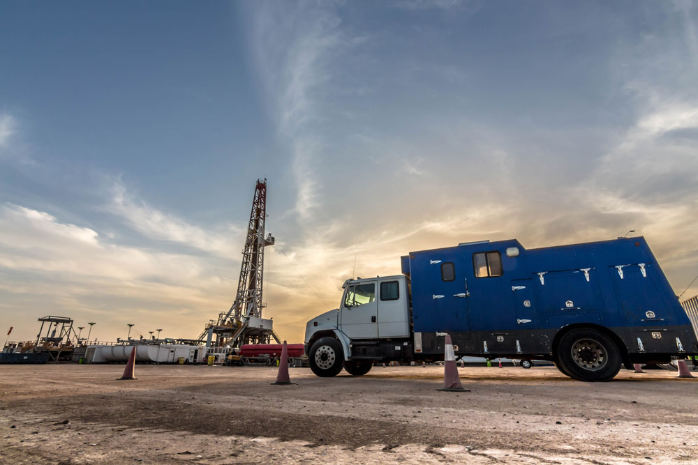 a truck moves inventory on an oil field