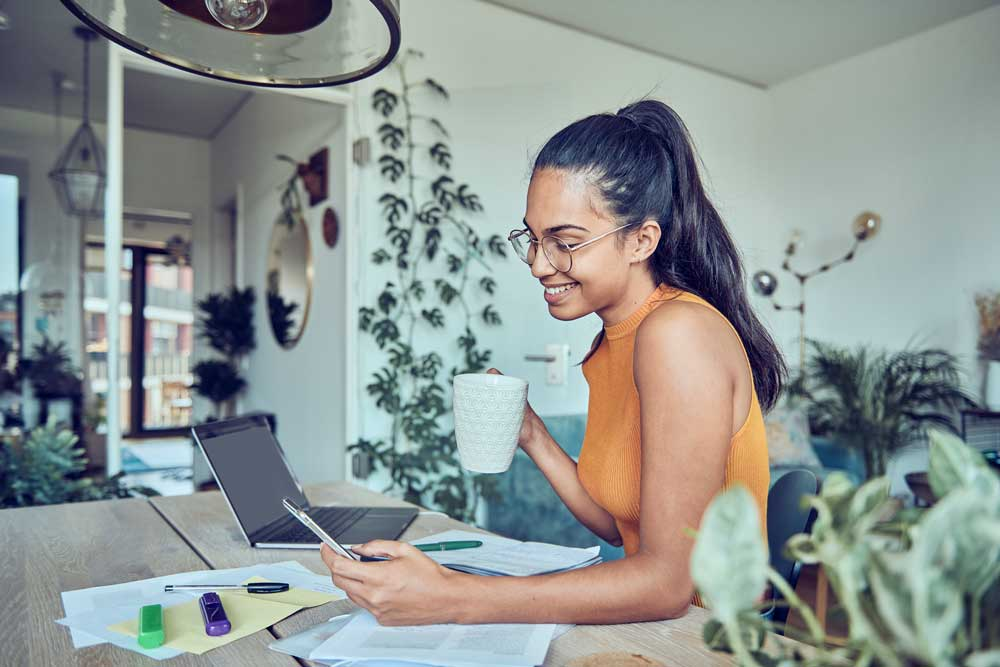 a young woman checks her savings CD balance on her phone