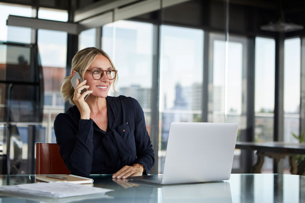 a woman contacts her Broadway Bank Commercial Banking team