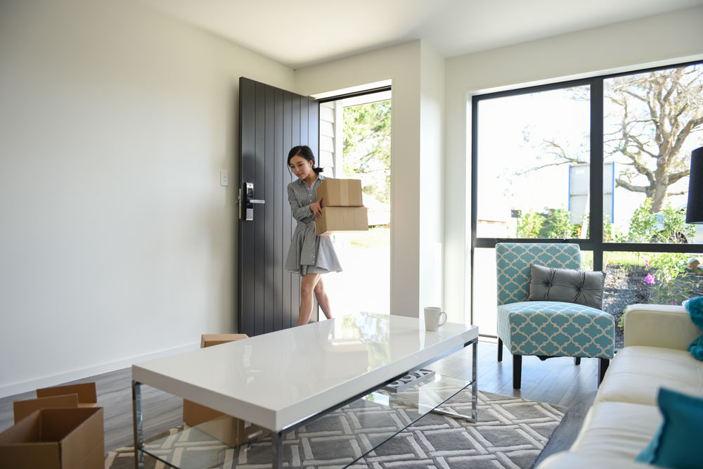 a woman furnishes her first home